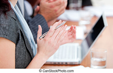 Close-up of business people applauding a good presentation