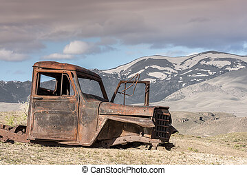 Antique rusted puckup truck and Idaho mountains - Old rusted...