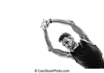 Handsome male athlete is doing exercise - Portrait of...