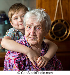 Elderly woman, grandson at blurring - Portrait of an elderly...