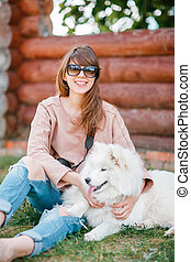 young woman girl white dog jeans - young stylish hipster...