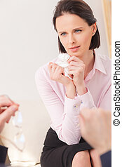 Attractive businesswoman is visiting a psychotherapist -...