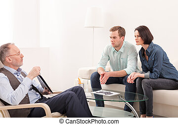 Husband and wife are consulting a psychologist - Mature...