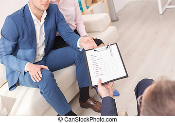 Young family is visiting a psychotherapist - Professional...