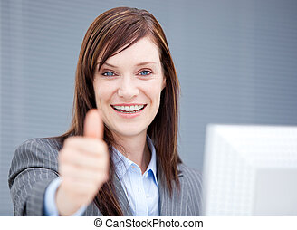 Successful businesswoman with a thumb up