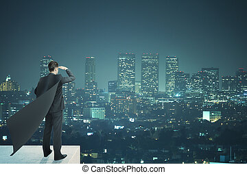 Businessman with black cape night - Businessman with black...