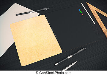 Beige and black notepad