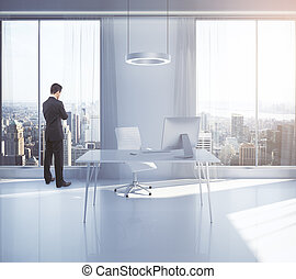 Thoughtful man in office - Thoughtful businessman looking...