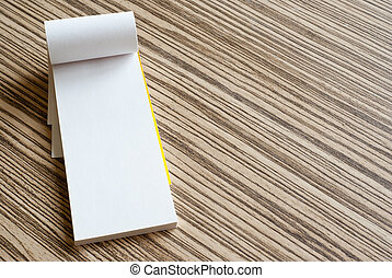 writing pad - White writing pad on wooden background