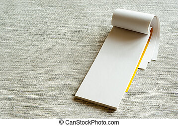 writing pad - White writing pad on grey background