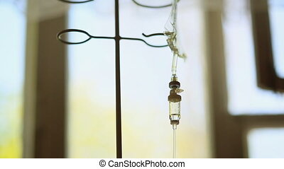 Medicine dropper in hospital. Dripping a drop of medicine. -...