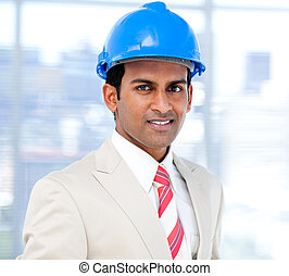 Self-assured architect standing  in the company