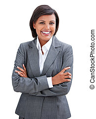 Positive businesswoman with folded arms standing against a...