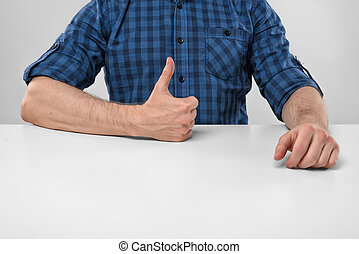 Close-up hands of man showing thumbs up Hand gesture Good...