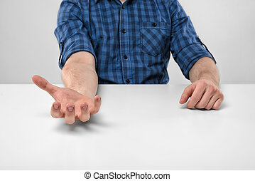 Close-up hands of man holding something in his palm Palm up...