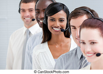 Multi-ethnic customer service representatives with headset on standing in a line