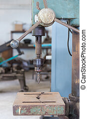 Drill press in a mechanical worksho - Industrial iron drill...