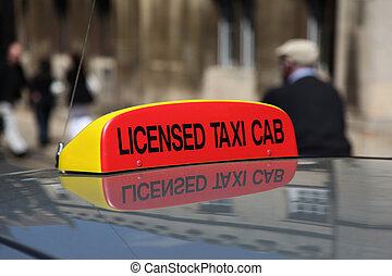 A licensed taxi cab sign in England