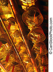Rows of incense coils hanging in a Chinese Temple in Hong Kong.