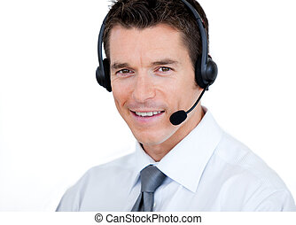 Smiling businessman using a headset