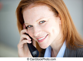 Self-assured business woman taking a call in the company