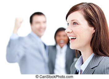 Laughing businesswoman standing with her team against a white background