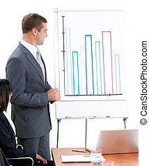 Attractive young businessman doing a presentation