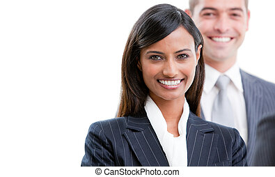 Smiling young business people standing in a row against a...