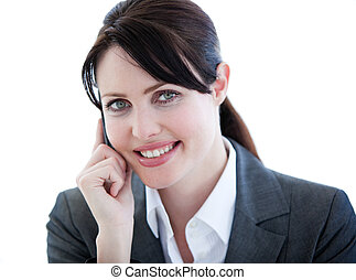 Smiling busineswoman on phone at her desk