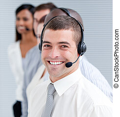 Cheerful customer service representatives standing in a line...