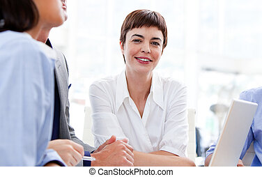 Confident businesswoman in a meeting