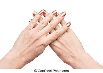Two hands with crossed fingers - Two female hands with the...