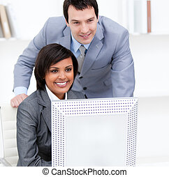 Two business partners working at a computer