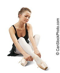 ballerina in black has dressed pointes - young ballerina...