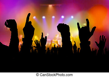 Concert crowd hands supporting band on stage - Concert crowd...
