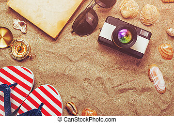 Summer holiday vacation accessories on beach sand