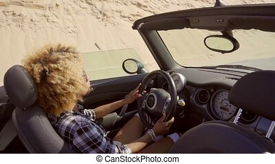 Young Black Woman Driving The Cabriolet - Young sexy woman...