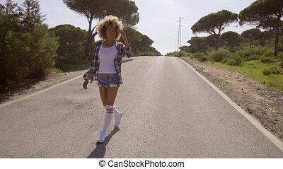 Woman Walking Down The Country Road - Young afro-american...