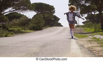 Woman Walking Down The Country Road - Slow motion view of...