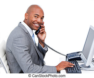 Smiling Afro-American businessman talking on phone