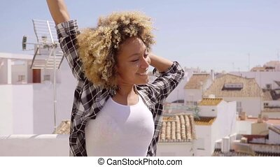 Woman Have Fun On Rooftop - Young happy mixed-race woman...