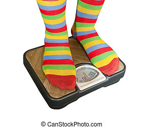 Feet placed on scales - Woman weighing herself on a bathroom...
