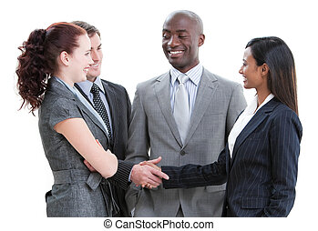 Jolly business partners shaking hands standing against a...