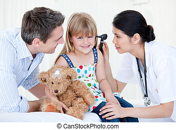 Smiling girl looks happy with her teddy bear