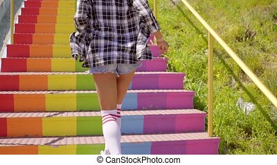 Young Woman Running Up The Stairs - Young exotic woman in...