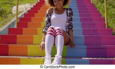 Young Woman Sitting On The Colorful Stairs - Young...