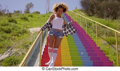 Gorgeous sexy young woman dancing down steps - Gorgeous sexy...
