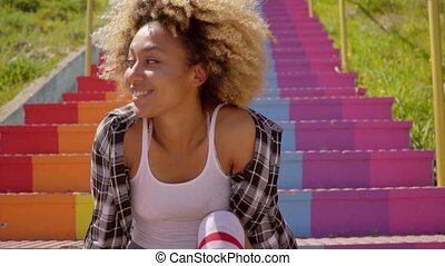 Young Woman Sitting On The Colorful Stairs. - Young...