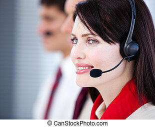 Concentrated sales representative team with an headset in...