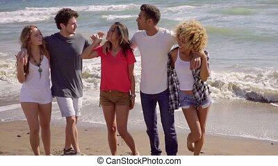 Young People On The Beach - Five young attractive people...